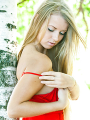 Stella Lane sensually poses outdoors baring her delectable body.