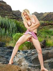 Janelle B flaunts her amazing body outdoors.