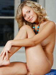 Olivvia A smiles enticingly as she cups her round, puffy breasts before posing confidently before Alex Sironi's camera.