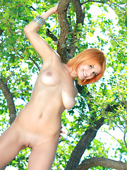 Violla delivers a delightful and fun series,   stripping and posing sensually among rugged   terrain and towering trees and evokes a   striking feminine radiance and elegant   composure outdoors.